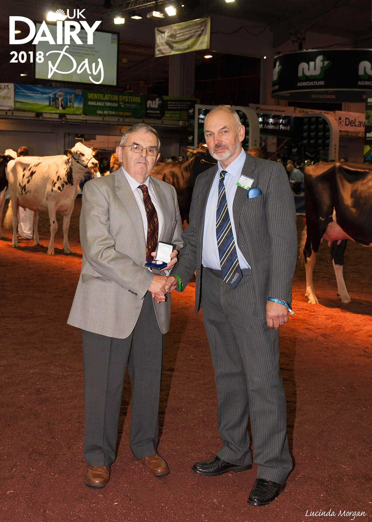 Photograph: Mr Keith Davies being presented with his Distinguished Service award by Holstein UK President Peter Waring.